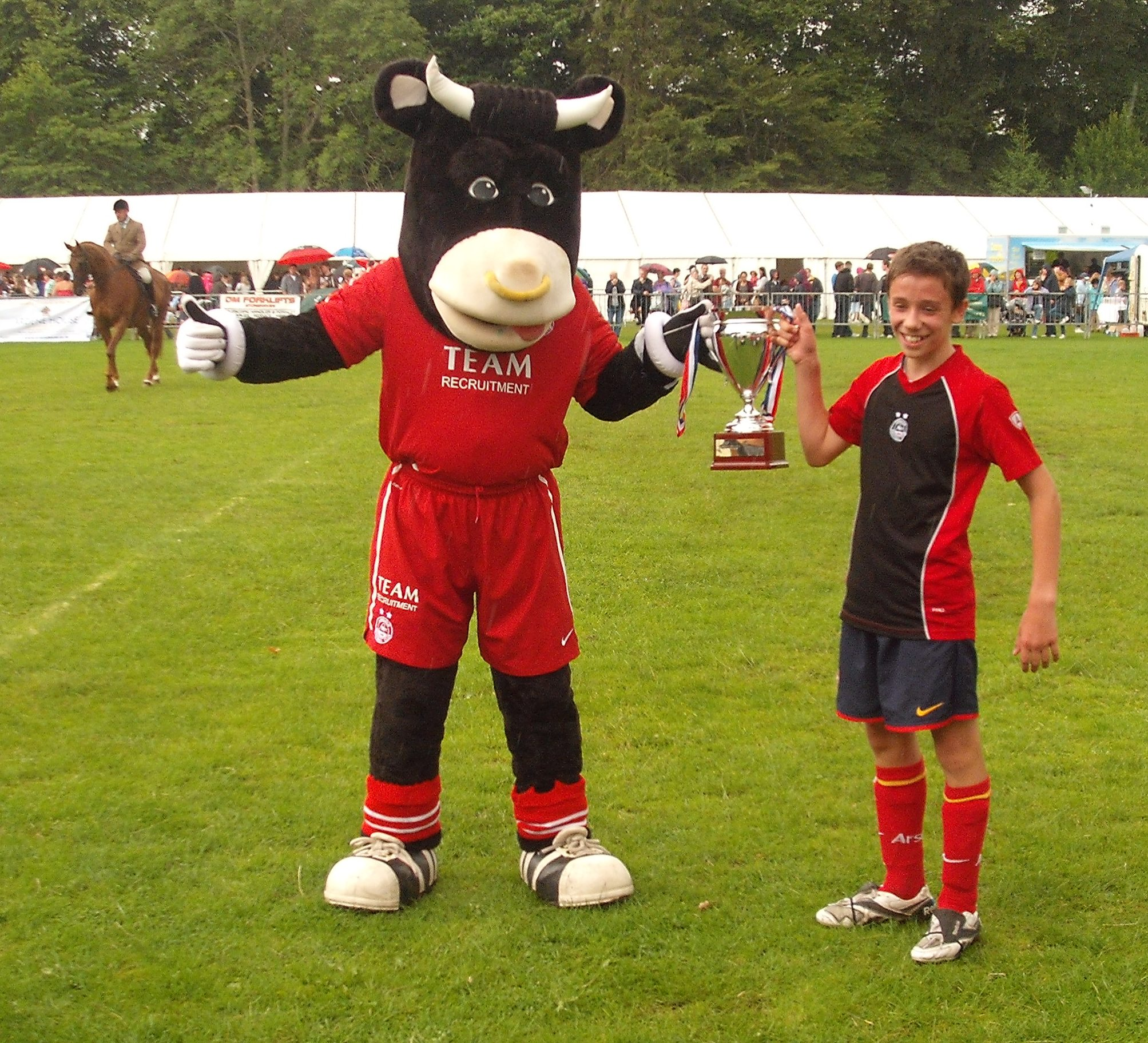 Angus the Bull presenting winning cup